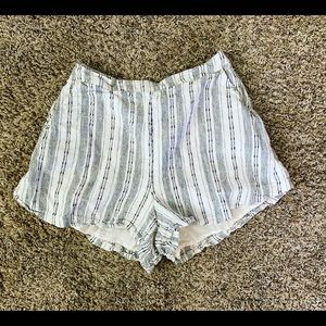White and black striped shorts with pockets